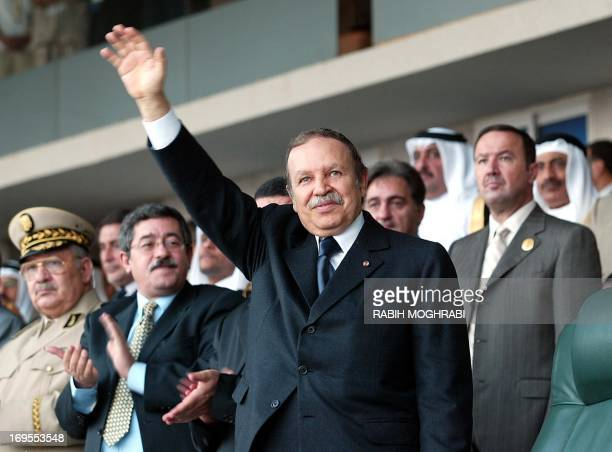 Algerian President Abdelaziz Bouteflika attends the opening ceremony of the 10th Arab Games at the July 5th stadium in Algiers 24 September 2004...