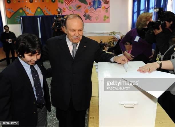 Algerian President Abdelaziz Bouteflika casts his vote accompanied by a nephew in the Sheikh Bashir El Ibrahima school in Algiers on April 9 2009...