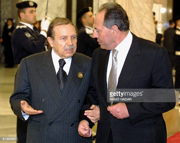 Algerian President Abdelaziz Bouteflika chats with Lebanese President Emile Lahoud prior to an official dinner given in honor of the leaders...