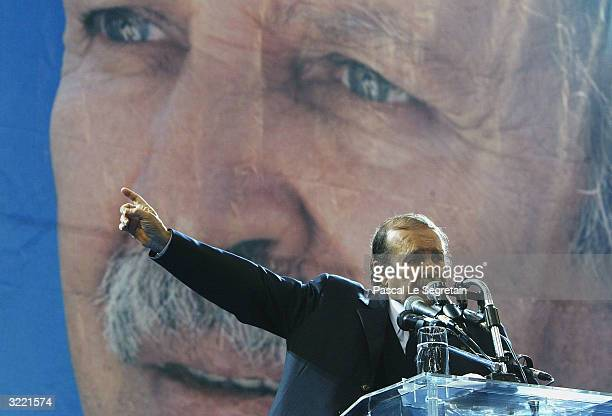 Algerian President Abdelaziz Bouteflika gestures as he speaks during a campaign rally April 5 2004 ahead of this weeks general election in Algiers...