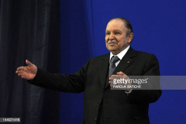 Algerian President Abdelaziz Bouteflika gestures on May 8 2012 during a commemoration ceremony of the May 8 1945 massacre in Setif when French...