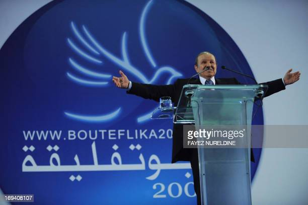Algerian President Abdelaziz Bouteflika gestures to his supporters during an election campaign rally on March 25 2009 in Bejaia 250 km east of...