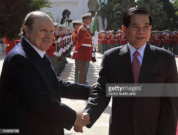 Algerian President Abdelaziz Bouteflika greets his Vietnamese counterpart Nguyen Minh Triet on April 14 2010 before their meeting in Algiers Triet...