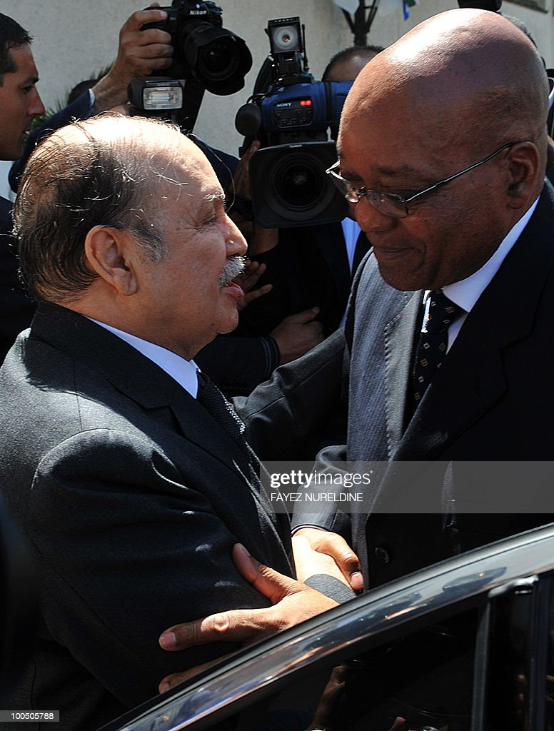 Algerian President Abdelaziz Bouteflika (L) hugs his South African counterpart Jacob Zuma during a welcoming ceremony at the Presidential Palace, on May 25, 2010 in Algiers. Zuma is on a two-day official visit to Algeria.