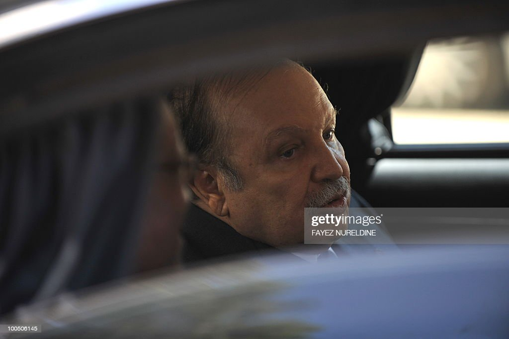 Algerian President Abdelaziz Bouteflika is pictured in his limousine as he chats with his South African counterpart Jacob Zuma (L/face partly hidden ) at the end of their press conference held at the presidential palace on May 25, 2010 in Algiers. Zuma is on a two-day official visit to Algeria.