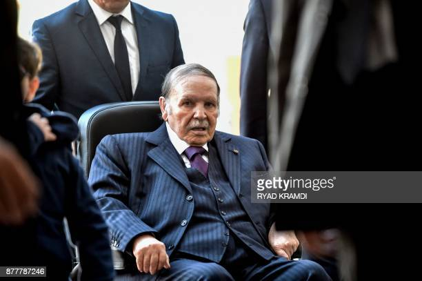 Algerian President Abdelaziz Bouteflika is seen heading to vote at a polling station in Algiers on November 23, 2017 as Algeria goes to the polls for...
