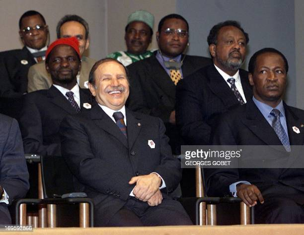 Algerian President Abdelaziz Bouteflika laughs as he listens to a protocol head speaking 18 January 2001 at the 21st FrancoAfrican summit in Yaounde...