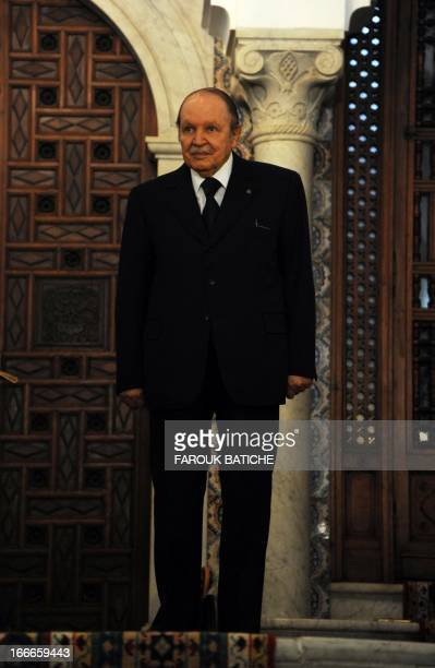 Algerian President Abdelaziz Bouteflika listens as his South African counterpart Jacob Zuma speaks upon the latter's arrival at the People's Palace...