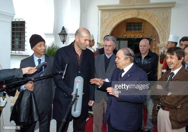 Algerian President Abdelaziz Bouteflika meets French football player Zinedine Zidane his father Smail accompanied by two brothers of Bouteflika Said...