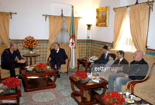 Algerian President Abdelaziz Bouteflika meets French football player Zinedine Zidane accompanied by two brothers of Bouteflika Said and Mustapha on...