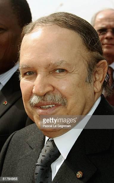Algerian President Abdelaziz Bouteflika poses as he arrives to attend the 10th Francophonie on November 26 2004 in Ouagadougou BurkinaFaso The summit...