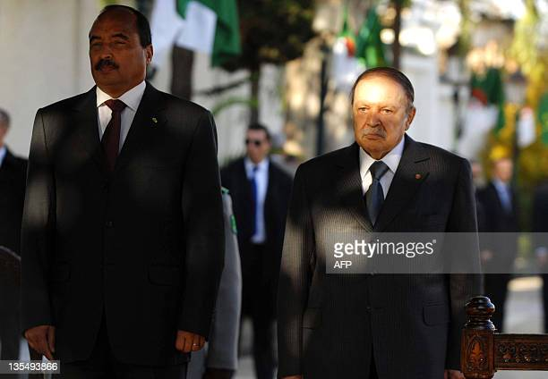 Algerian President Abdelaziz Bouteflika stands with his Mauritanian counterpart Mohamed Ould Abdel Aziz in Algiers on December 11 2011 Aziz arrived...