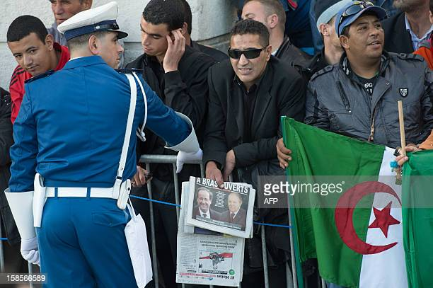 Algerian President Abdelaziz Bouteflika supporters line the street as they wait for him and French President Francois Hollande to drive past in...