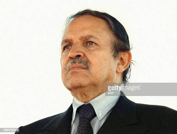 Algerian President Abdelaziz Bouteflika waits for the arrival of Libyan leader Moamer Kadhafi at Algiers airport 10 July 1999 two days before the...