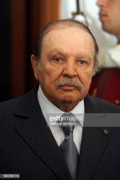 Algerian President Abdelaziz Bouteflika walks past a ceremonial guard during a meeting with Mauritanian President Mohamed Ould Abdel Aziz in Algiers...