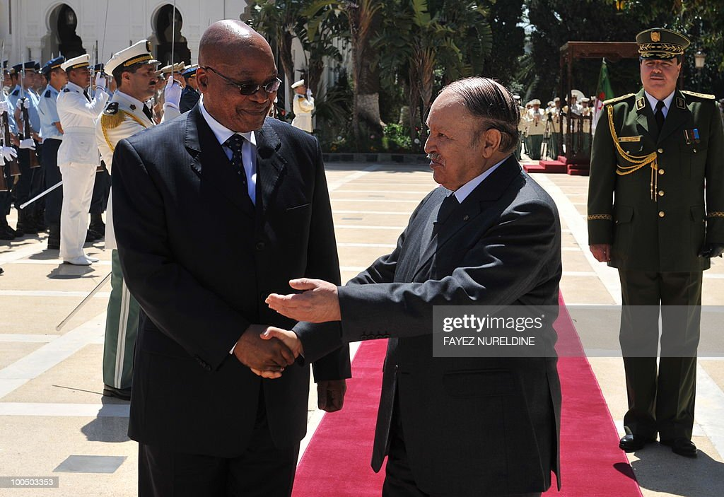 Algerian President Abdelaziz Bouteflika (L) welcomes his South African counterpart Jacob Zuma during a welcoming ceremony at the Presidential Palace, on May 25, 2010 in Algiers. Zuma is on a two-day official visit to Algeria.