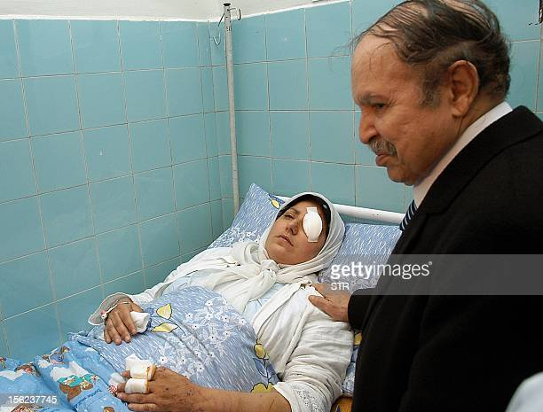 Algerian President Abdelazziz Bouteflika comforts an injured woman a victim of the suicide bomb car attack against the Prime Ministry headquarters...