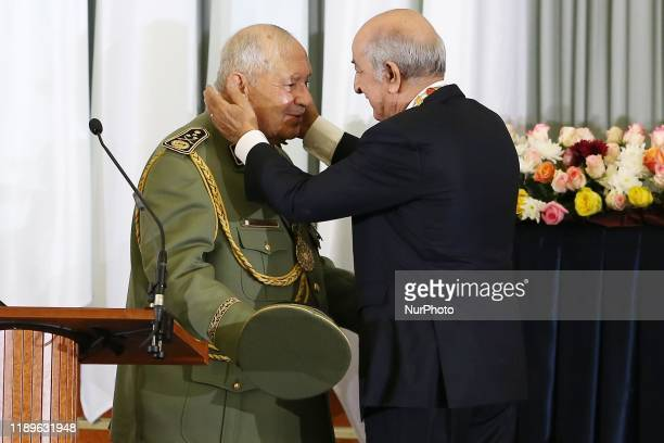 Algerian President Abdelmadjid Tebboune and kisses general of the armed forces General Ahmed Gaid Salah during the swearingin ceremony in Algiers...