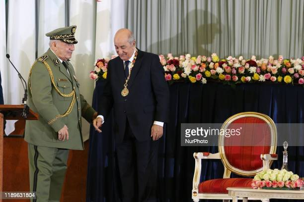 Algerian President Abdelmadjid Tebboune kisses armed forces chief Lieutenant general Ahmed Gaid Salah during the swearingin ceremony in Algiers...