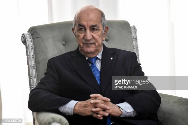 Algerian President Abdelmadjid Tebboune meets with the visiting French Foreign Minister in the capital Algiers on January 21, 2020. - Le Drian...
