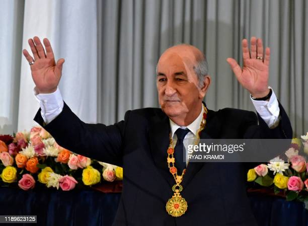 Algerian President Abdelmadjid Tebboune waves during the formal swearing-in ceremony in the capital Algiers on December 19, 2019. - The 74-year-old...