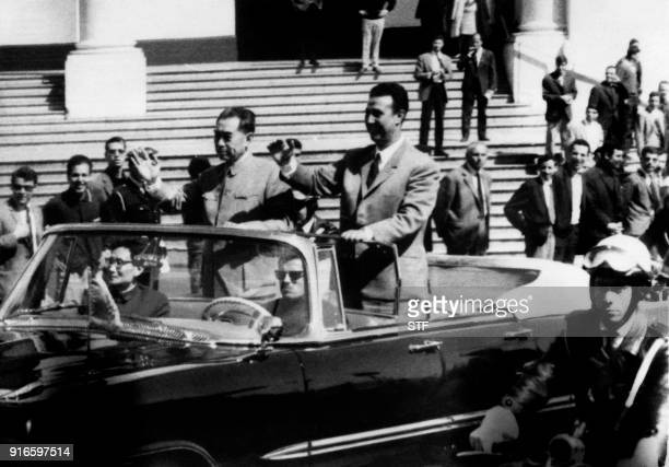Algerian President Ahmed Ben Bella and Chinese Prime minister Chou En Lai wave to the crowd in Algiers on March 31 1965 / AFP PHOTO / STF