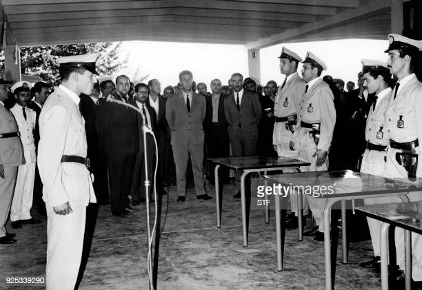 Algerian President Ahmed Ben Bella attends a police graduation ceremony in Hydra on June 3 1965 / AFP PHOTO / STF