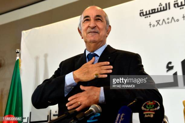 Algerian President-elect Abdelmadjid Tebboune greets attendees during a press conference in the capital Algiers, on December 13, 2019. - Abdelmadjid...