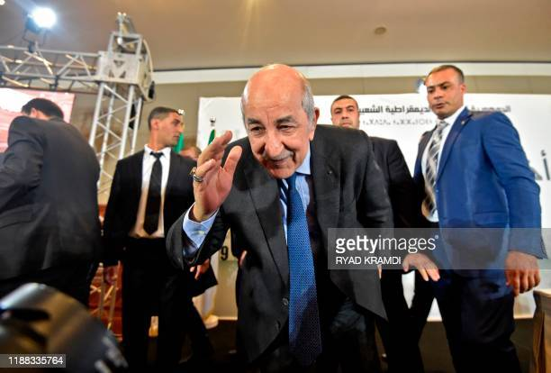 Algerian Presidentelect Abdelmadjid Tebboune greets attendees during a press conference in the capital Algiers on December 13 2019 Abdelmadjid...