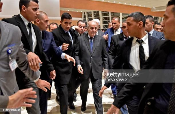 Algerian Presidentelect Abdelmadjid Tebboune is escorted from a press conference in the capital Algiers on December 13 2019 Abdelmadjid Tebboune a...