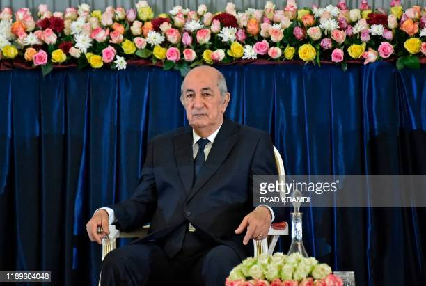 Algerian Presidentelect Abdelmadjid Tebboune sits during the formal swearingin ceremony in the capital Algiers on December 19 2019 The 74yearold...