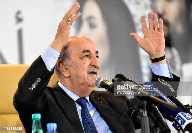 Algerian Presidentelect Abdelmadjid Tebboune waves to attendees during a press conference in the capital Algiers on December 13 2019 Abdelmadjid...
