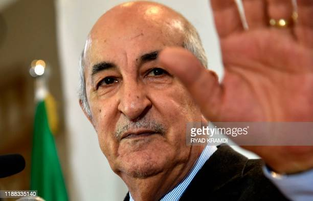 Algerian Presidentelect Abdelmadjid Tebboune waves to greet attendees during a press conference in the capital Algiers on December 13 2019...