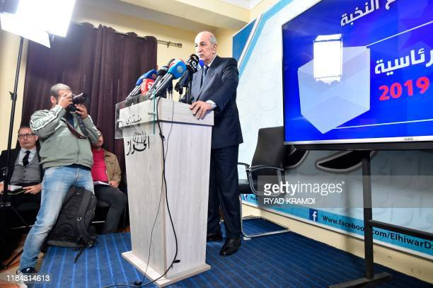 Algerian presidential candidate Abdelmadjid Tebboune attends a forum at the headquarters of alHiwar newspaper in the capital Algiers on November 24...