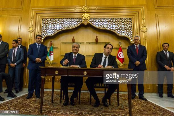 Algerian Prime Minister Abdelmalek Sellal and Tunisian Prime Minister Youssef Chahed attend the signing ceremony of the collaboration between Algeria...