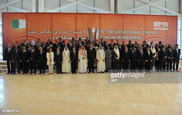 Algerian Prime Minister Abdelmalek Sellal poses with oil ministers from OPEC member states and other officials attending the opening session of the...