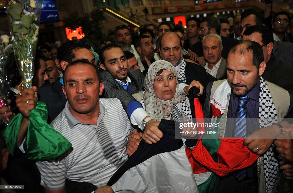 Algerian pro-Palestinian activists (C), who were detained aboard the Gaza-bound aid flotilla raided by Israel on May 31, 2010, are welcomed by supporters upon arrival at Algiers International aiport early on June 3, 2010. Thirty two Algerian activists deported from Israel arrived in Algiers following their release from arrest by Israel after its deadly raid on an aid flotilla headed for Gaza.