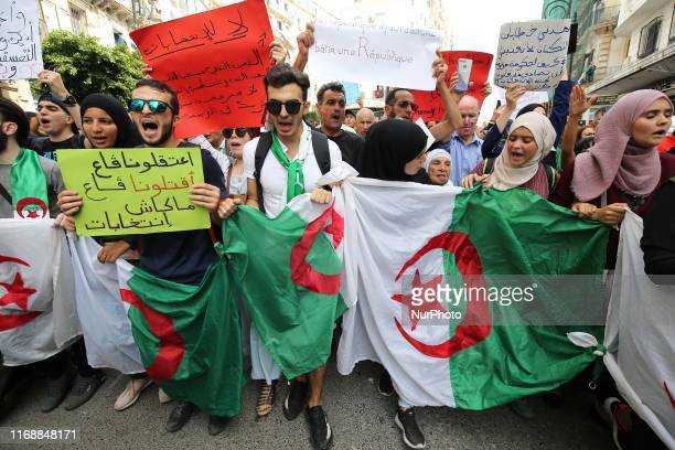 Algerian protesters carrying national flags chanted slogans during the student demonstration in Algiers Algeria on September 17 2019 Algeria will...
