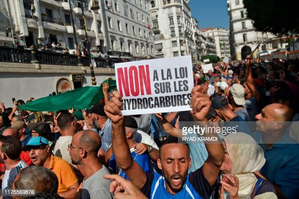 Algerian protesters chant antigovernment slogans during a protest near the parliament building in Algiers on October 13 2019 against the military's...