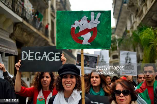 Algerian protesters demonstrate against their ailing president's bid for a fifth term in power, in Algiers on March 8, 2019. -
