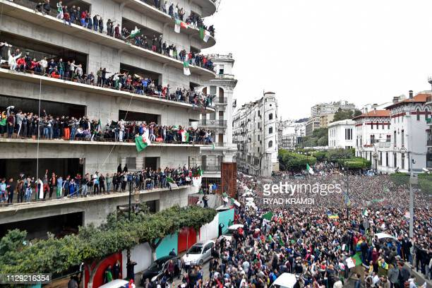 Algerian protesters demonstrate against their ailing president's bid for a fifth term in power in Algiers on March 8 2019
