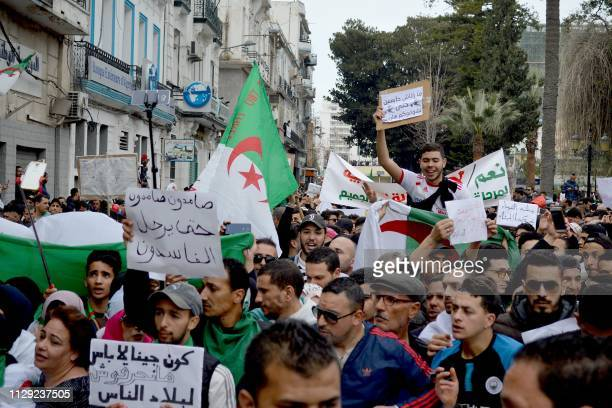 Algerian protesters demonstrate against their ailing president's bid for a fifth term in power in Algiers on March 8 2019 Tens of thousands protested...
