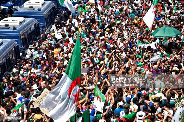 Algerian protesters demonstrate in Algiers on July 12 in the latest in weeks of rallies against the ruling class amid an ongoing political crisis in...