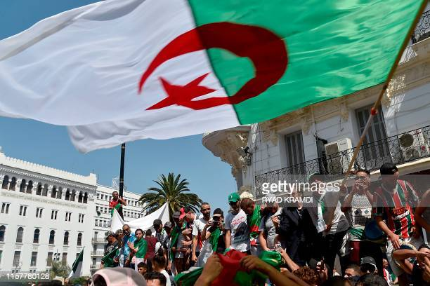 Algerian protesters demonstrate in Algiers on July 26 in the latest in weeks of rallies against the ruling class amid an ongoing political crisis in...