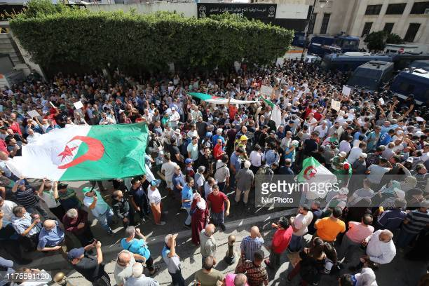 Algerian protesters face riot police at a demonstration near the parliament building in Algiers on October 13, 2019 against the draft hydrocarbons...
