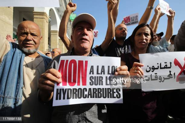 Algerian protesters face riot police at a demonstration near the parliament building in Algiers on October 13 2019 against the draft hydrocarbons law...