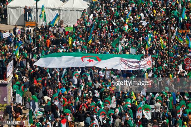 TOPSHOT Algerian protesters gather during a mass demonstration against ailing President Abdelaziz Bouteflika in the capital Algiers on March 29 2019...