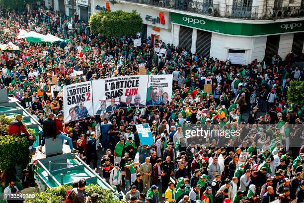 Algerian protesters gather during a mass demonstration against ailing President Abdelaziz Bouteflika in the capital Algiers on March 29 2019...