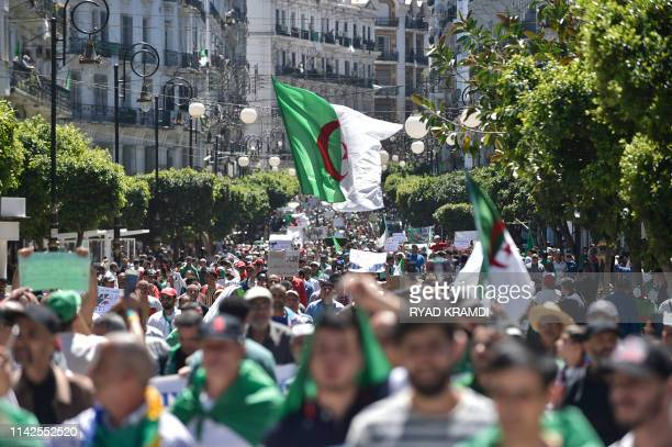 Algerian protesters march with national flags during an antigovernment demonstration in the capital Algiers on May 10 2019 Protesters thronged the...