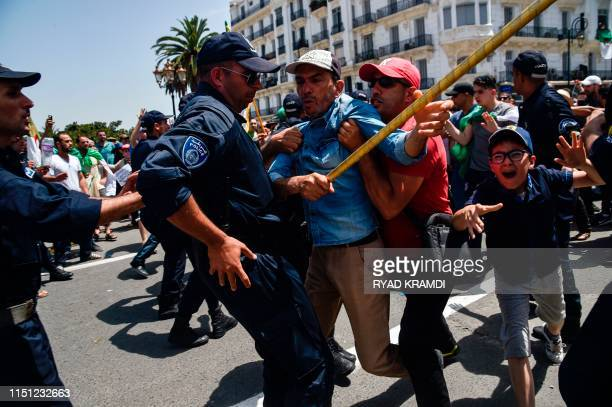 Algerian protesters scuffle with members of the security forces during the weekly Friday demonstration in the capital Algiers on June 21 2019...